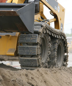 Skid steer with over the tire tracks