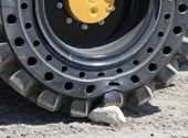 mclaren solid cushion tire on cat backhoe