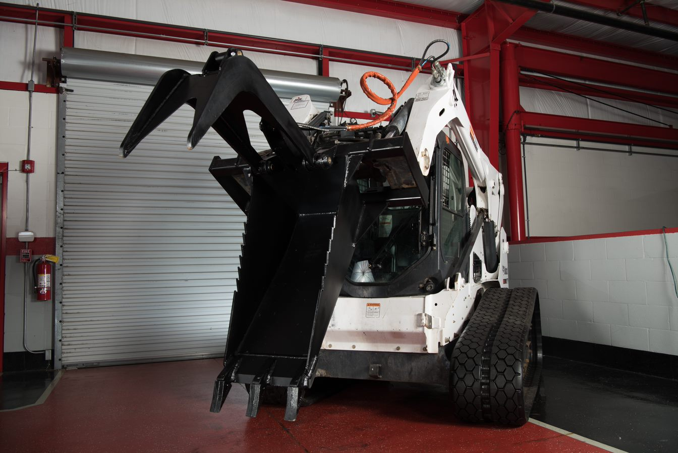 skid steer stump bucket on bobcat track loader