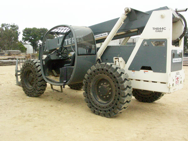 Telehandler with solid rubber tires
