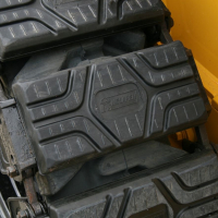 Steel vs. Rubber Skid Steer Over-the-Tire-Tracks: Which to Choose
