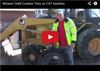 Mclaren Solid Cushion Tires on CAT backhoe
