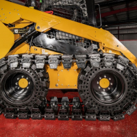 Over-The-Tire Tracks vs. Dedicated Track Loaders