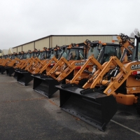 Over 100 CASE backhoe loaders with McLaren Nu-Air DT solid cushion tires lined up for CSX Transportation