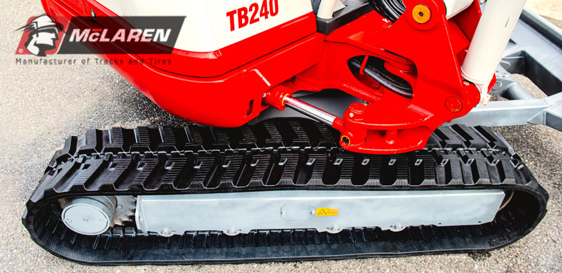 Mini excavator with McLaren rubber tracks