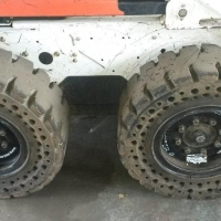 McLaren Nu-Air Tires on Bobcat S175 in metal recycling