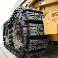 McLaren Rubber over-the-tire tracks on a John Deere 320 skid steer loader