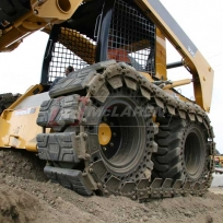 McLaren Rubber over-the-tire tracks for skids teer loaders