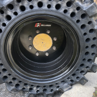 Press-On vs. Bonded Wheel Solid Skid Steer Tires
